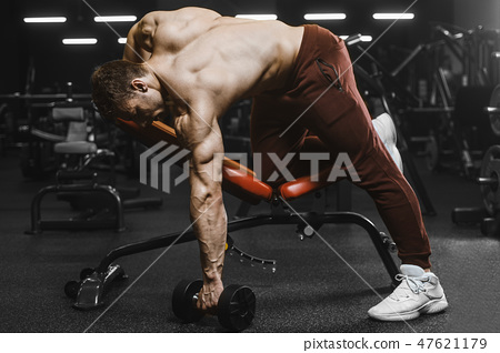 Handsome strong athletic men pumping up muscles workout bodybuil 47621179