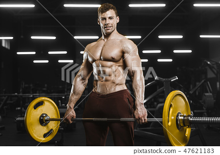 Handsome strong athletic men pumping up muscles workout bodybuil 47621183