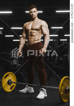 Handsome strong athletic men pumping up muscles workout barbell 47621185