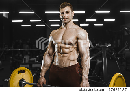 Handsome strong athletic men pumping up muscles workout bodybuil 47621187