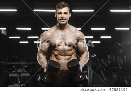 Handsome strong athletic men pumping up muscles workout barbell 47621192