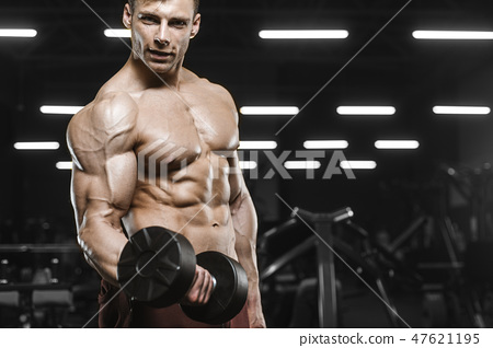 Handsome strong athletic men pumping up muscles workout barbell 47621195