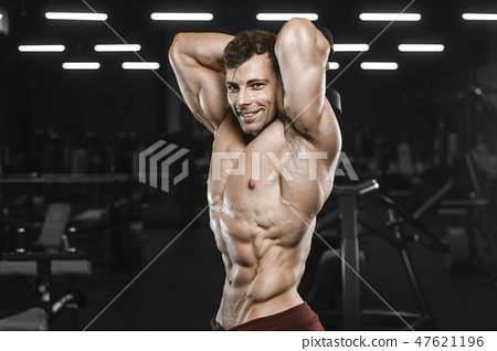 Handsome strong athletic men pumping up muscles workout bodybuil 47621196