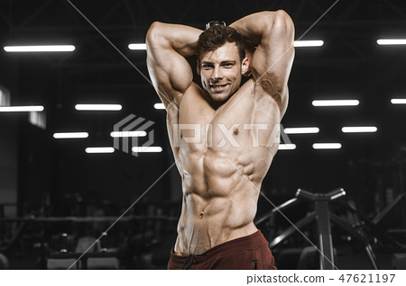 Handsome strong athletic men pumping up muscles workout bodybuil 47621197