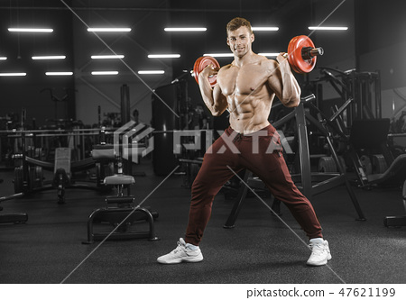 Handsome strong athletic men pumping up muscles workout barbell 47621199