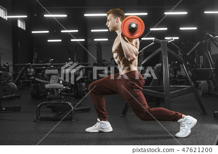 Handsome strong athletic men pumping up muscles workout barbell 47621200