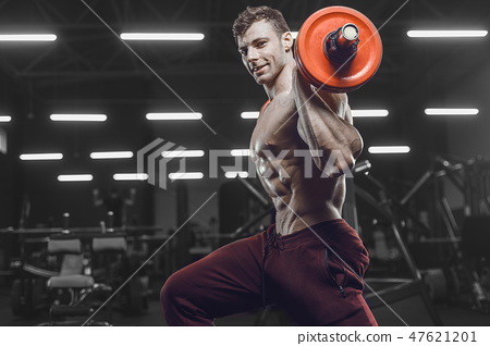 Handsome strong athletic men pumping up muscles workout barbell 47621201