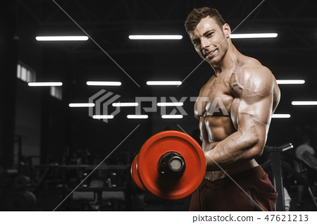 Handsome strong athletic men pumping up muscles workout barbell 47621213