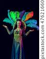 Beautiful young woman in carnival peacock costume 47621660