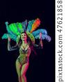 Beautiful young woman in carnival peacock costume 47621858