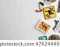 Magnet souvenirs on white refrigerator 47624440
