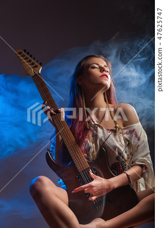 Girl and electric guitar 47625747