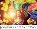 Beautiful young woman in carnival peacock costume 47629522