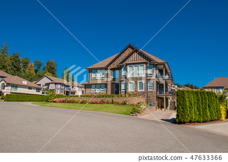 Luxury house in center of the neighborhood on blue sky background 47633366