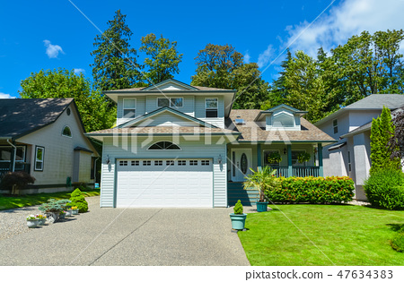 Suburban house with mountain view and blue sky background for sale 47634383