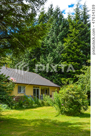 Frontage of a nice house among trees on country side in British Columbia, Canada 47634389
