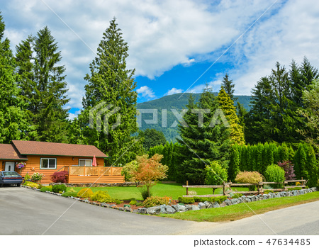North American family house in rural area with nicely landscaped front yard 47634485