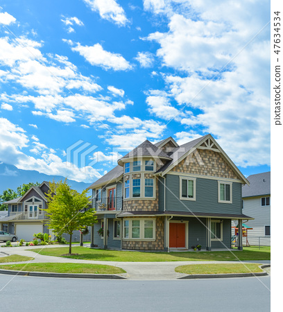 Luxury family house on cloudy, blue sky background in British Columbia, Canada. 47634534