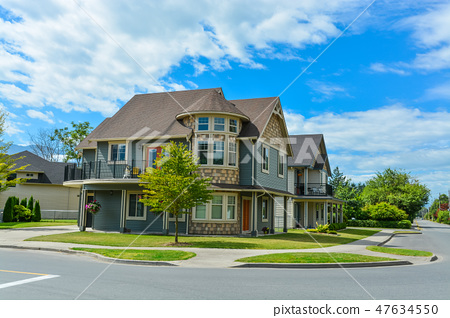 Luxury family house on cloudy, blue sky background in British Columbia, Canada. 47634550