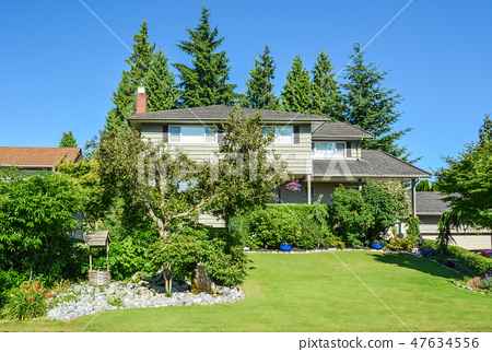 Nicely decorated front yard of family house 47634556
