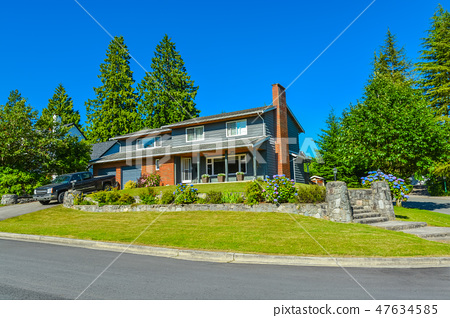 North american family house with landscaping and blue sky background 47634585