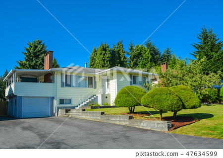 North american family house with asphalt driveway and stairway to the entrance 47634599