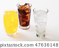 Glasses of soda drink with ice cubes and bubbles 47636148