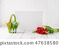 Easter composition with flowers and white board 47638580