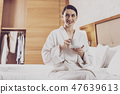 Pleasant woman resting in hotel room 47639613