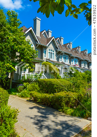 Residential townhouses on sunny day in Vancouver, British Columbia, Canada. 47639922