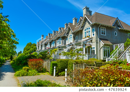 Residential townhouses on sunny day in Vancouver, British Columbia, Canada. 47639924