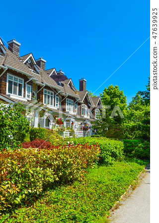 Residential townhouses on sunny day in Vancouver, British Columbia, Canada. 47639925