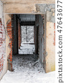 Brick ruins of an old house in the snow 47643677