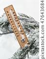 thermometer with subzero temperature stuck in the snow   47643684