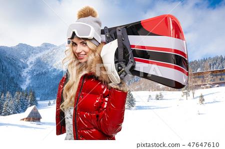 blonde snowboarder on snow 47647610