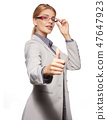 Happy smiling business woman with thumbs up gesture 47647923