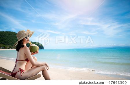 Sexy woman in the red bikini on beach 47648390