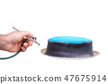 Hand of chef using airbrush for cake decorating on white isolated background. 47675914