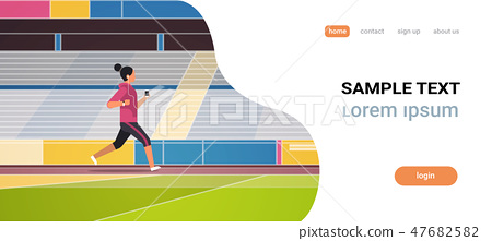 fitness woman running stadium track girl listening to music with headphones on smartphone healthy 47682582