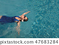 asian girl with swimming suite and sun glasses on pool 47683284