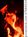 Fire monster portrait - face from fire flames 47684034