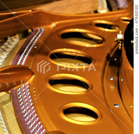 Cast iron plate covering the soundboard of the grand piano 47688582