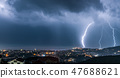 Night cityscape with lightning over it 47688621