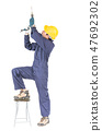 Handyman standing with his electric drill with clipping path 47692302