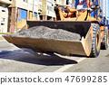 Heavy construction bulldozer carries old asphalt 47699285