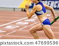 woman runner running relay race 47699596