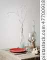 Festive winter table set with glass bottles 47700938
