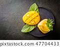 Healthy mango smoothie 47704433