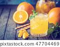Glass of fresh orange juice 47704469