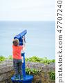Little boy looking through the telescope 47707240
